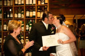 Celebrant Kathy Pynsent presenting marriage certificate